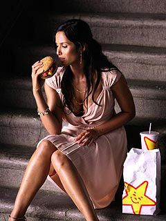Padma Lakshmi eating Carl'r Jr.